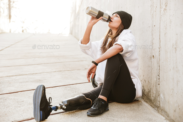 Photo of attractive young handicapped woman having bionic leg in - Stock Photo - Images