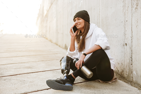 Photo of happy handicapped woman in casual wear having bionic le - Stock Photo - Images