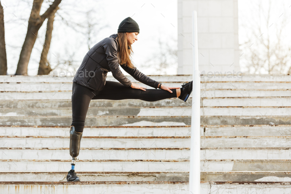 Image of disabled running girl in sportswear, doing sports and s - Stock Photo - Images