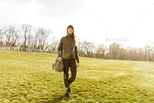 Picture of young handicapped girl with prosthetic leg in sportsw - Stock Photo - Images
