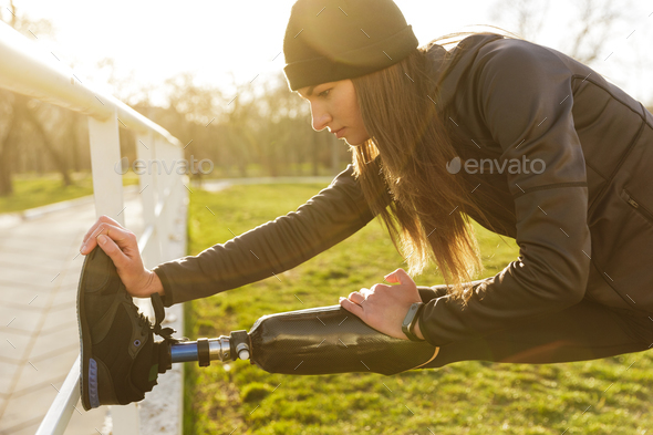 Image of disabled running woman in sportswear, doing slopes and - Stock Photo - Images