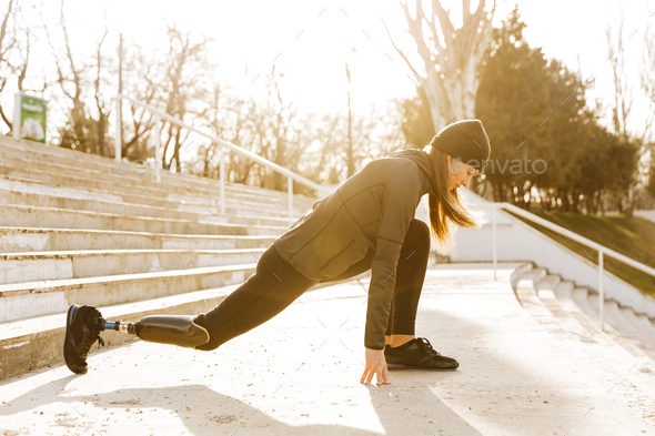 Image of disabled sporty woman in sportswear, doing sports and s - Stock Photo - Images