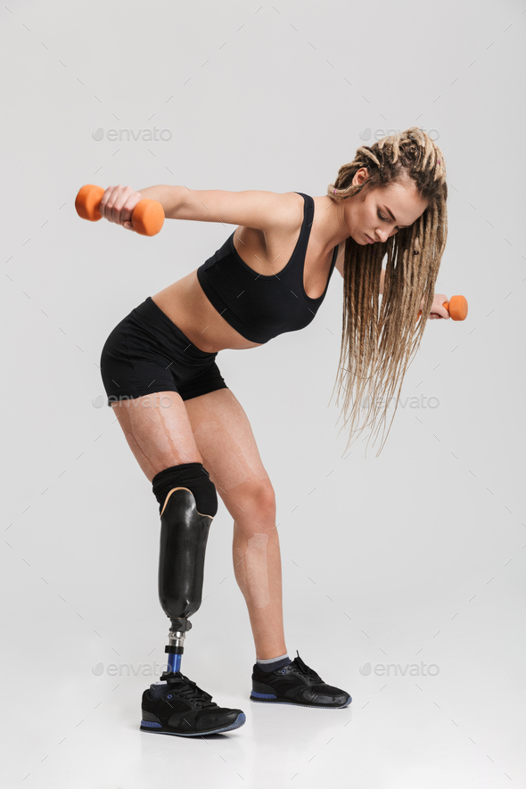 Healthy young disabled sportswoman make exercises with dumbbells. - Stock Photo - Images