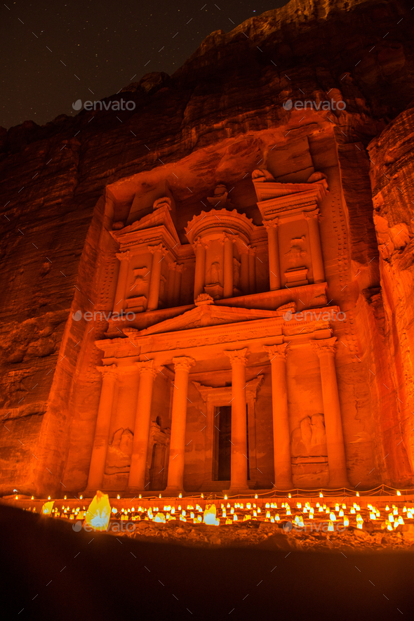 Petra by night, Jordan. The Treasury and the Siq canyon illuminated by candle lights - Stock Photo - Images