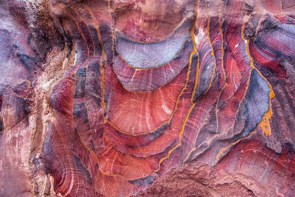 Red sandstone formation texture. Abstract geological pattern. Petra, Jordan - Stock Photo - Images