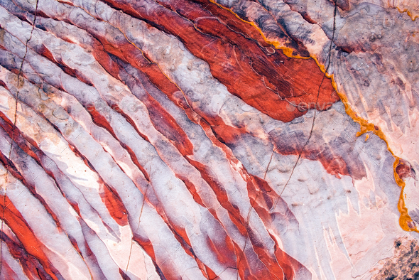 Geological pattern with white and red stripes - Stock Photo - Images