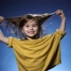 Cute Funny Little Girl Playing with Her Long Hair, Blue Background - VideoHive Item for Sale