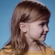 Cute Little Girl with Fair Hair Smiling Blue Background - VideoHive Item for Sale