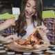 Pretty Young Girl Eating Pizza with Enjoy in Café - VideoHive Item for Sale