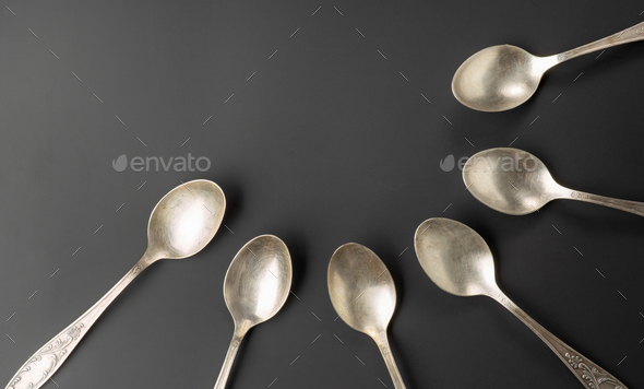 old silver spoons on black background - Stock Photo - Images