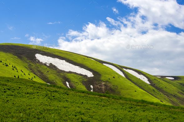 Spring landscape in mountains with snow - Stock Photo - Images