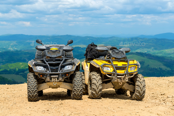 ATV Quad Bike in front of mountains landscape - Stock Photo - Images