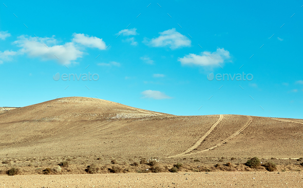 Volcanic hills and blue sky - Stock Photo - Images