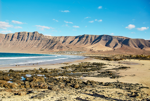 Landscape with volcanic hills and atlantic ocean in Lanzarote  - Stock Photo - Images