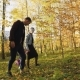 Lovely Parents with Their Little Daughter Walking in Autumn Park - VideoHive Item for Sale