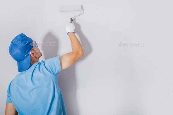 Men Painting His Apartment - Stock Photo - Images