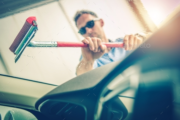 Cleaning Car Windshield - Stock Photo - Images
