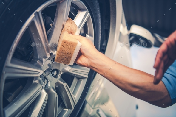Men Cleaning Car Alloy Wheel - Stock Photo - Images