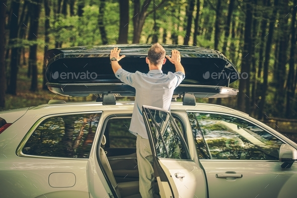 Installing Car Roof Cargo - Stock Photo - Images