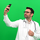 Doctor Taking Selfie on Green Screen - VideoHive Item for Sale