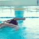 Teen Boy Professionally Swims in the Pool - VideoHive Item for Sale