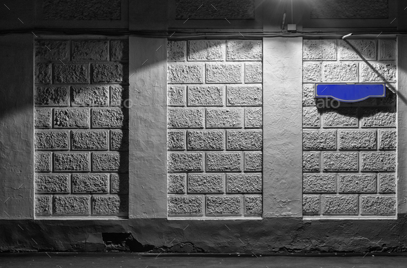 Wall of an building with a blank blue sign for the street name - Stock Photo - Images