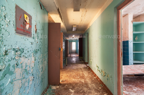 Corridor with open doors in an abandoned old building - Stock Photo - Images