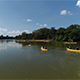 Flyover Canoes on a Jungle River - VideoHive Item for Sale