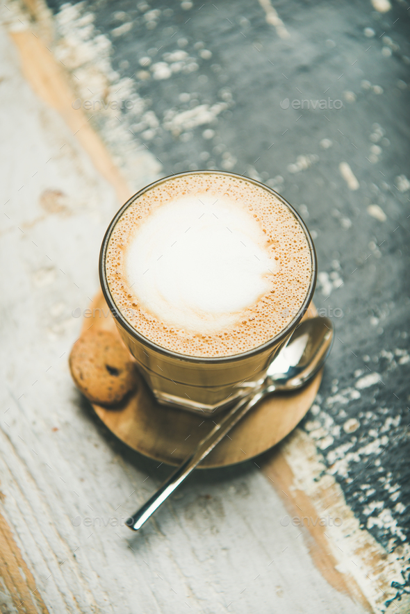 Latte coffee over rustic wooden painted background - Stock Photo - Images