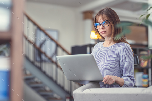 Young woman in the library - Stock Photo - Images