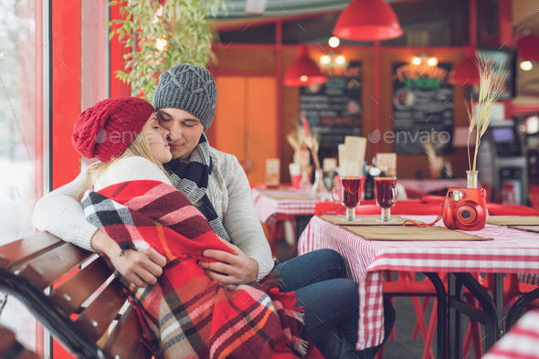 Embracing couple in a cafe - Stock Photo - Images