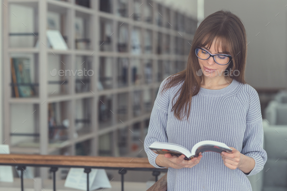 Young student with a book - Stock Photo - Images