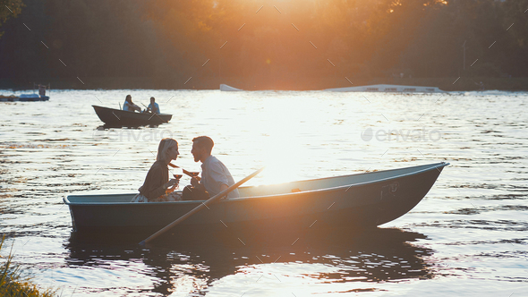 Young couple at sunset - Stock Photo - Images