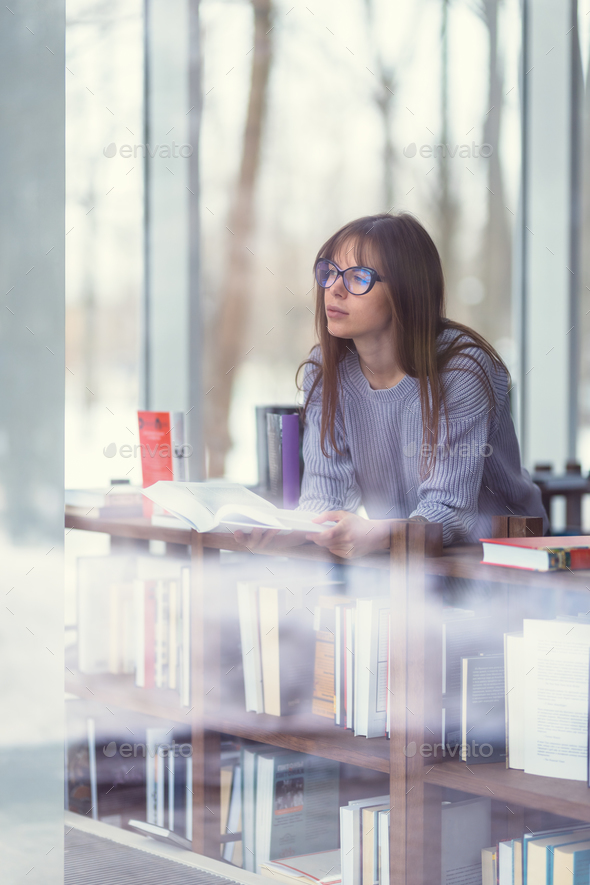 Young woman with books - Stock Photo - Images