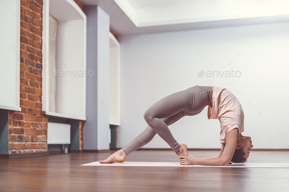 Young girl doing yoga - Stock Photo - Images