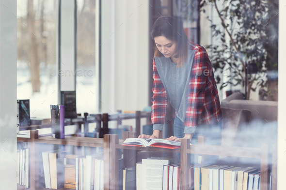 Young attractive woman in the library - Stock Photo - Images