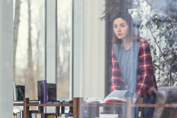 Young attractive woman with books - Stock Photo - Images