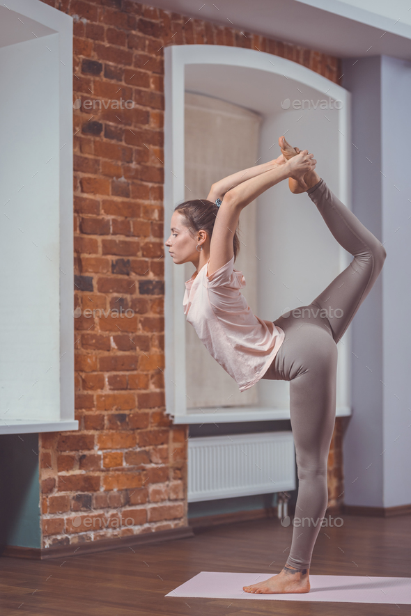 Attractive woman in yoga studio - Stock Photo - Images