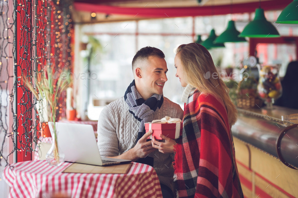 Young couple with a gift - Stock Photo - Images