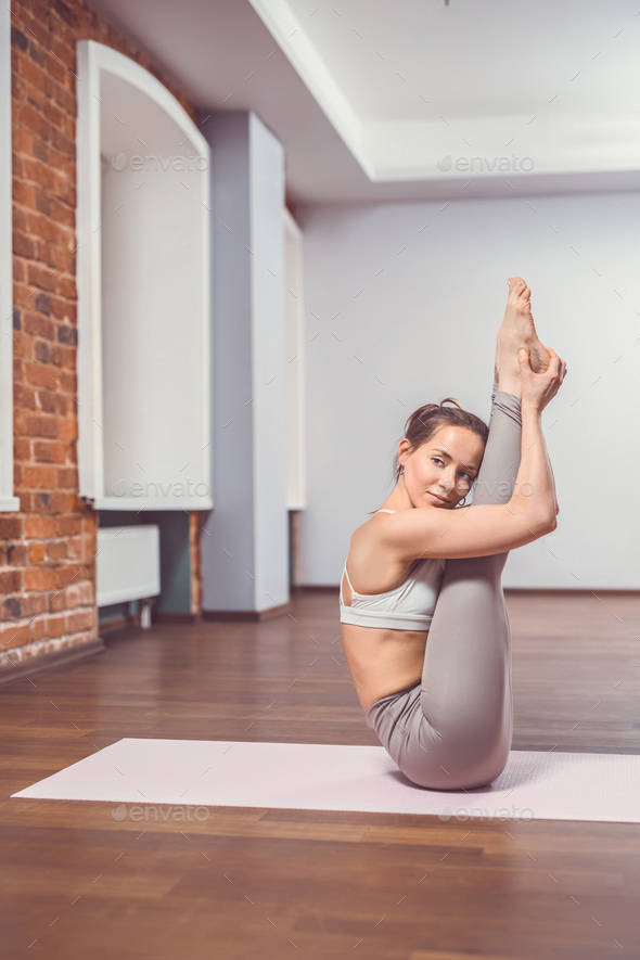 Attractive woman in yoga class - Stock Photo - Images