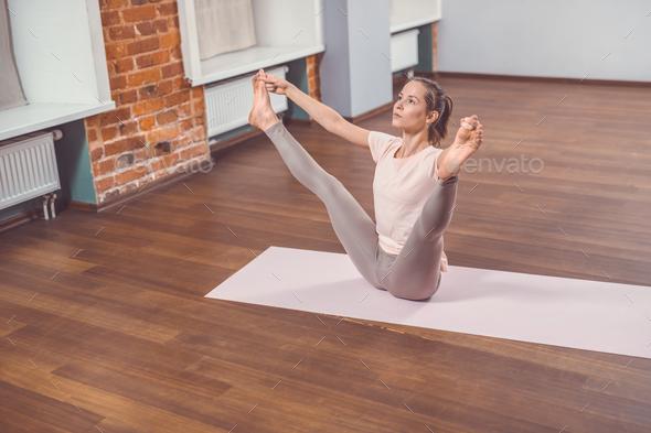 Active woman in yoga studio - Stock Photo - Images