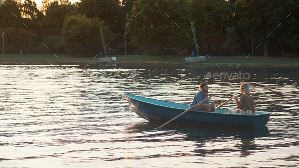 Young couple in a boat - Stock Photo - Images