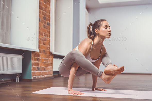 Young girl practicing yoga - Stock Photo - Images
