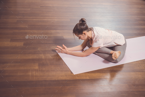 Young woman doing gymnastics - Stock Photo - Images