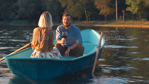 Smiling couple in the evening - Stock Photo - Images