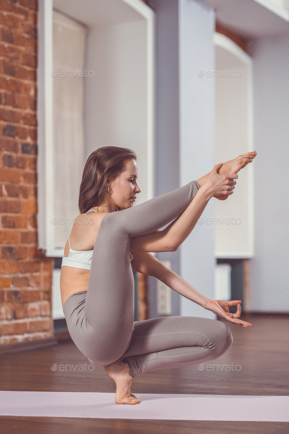 Young instructor practicing yoga - Stock Photo - Images
