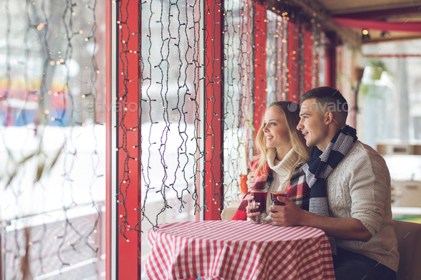 Smiling couple in a cafe - Stock Photo - Images