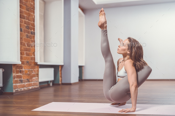 Attractive woman doing yoga - Stock Photo - Images