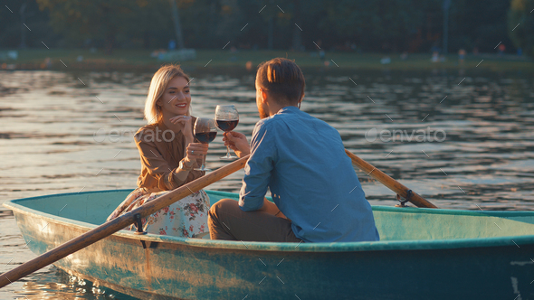 Happy young couple in a boat - Stock Photo - Images