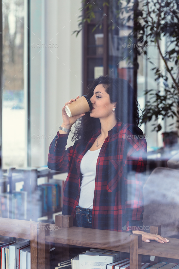 Young girl drinks coffee - Stock Photo - Images